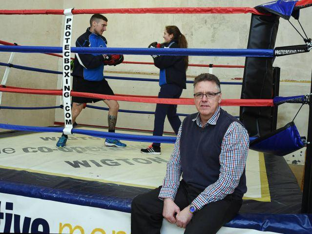 Paul Radcliffe ringside as Ben Hale takes boxer Kate Jackson through some sparring moves