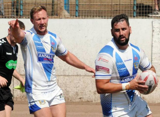 Back in the fold: Matthew Johnson points the way as Kurt Maudling crosses for a try against Hunslet