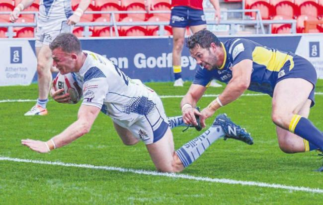 Crossing the whitewash: Town's Jake Moore powers over to score one of his two tries (Photo: Gary McKeating)