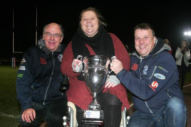 Champions: Workington Comets won the Knockout Cup last night as team manager Tony Jackson, owner Laura Morgan and co-promoter Steve Whitehead celebrate (Photo: David Payne)