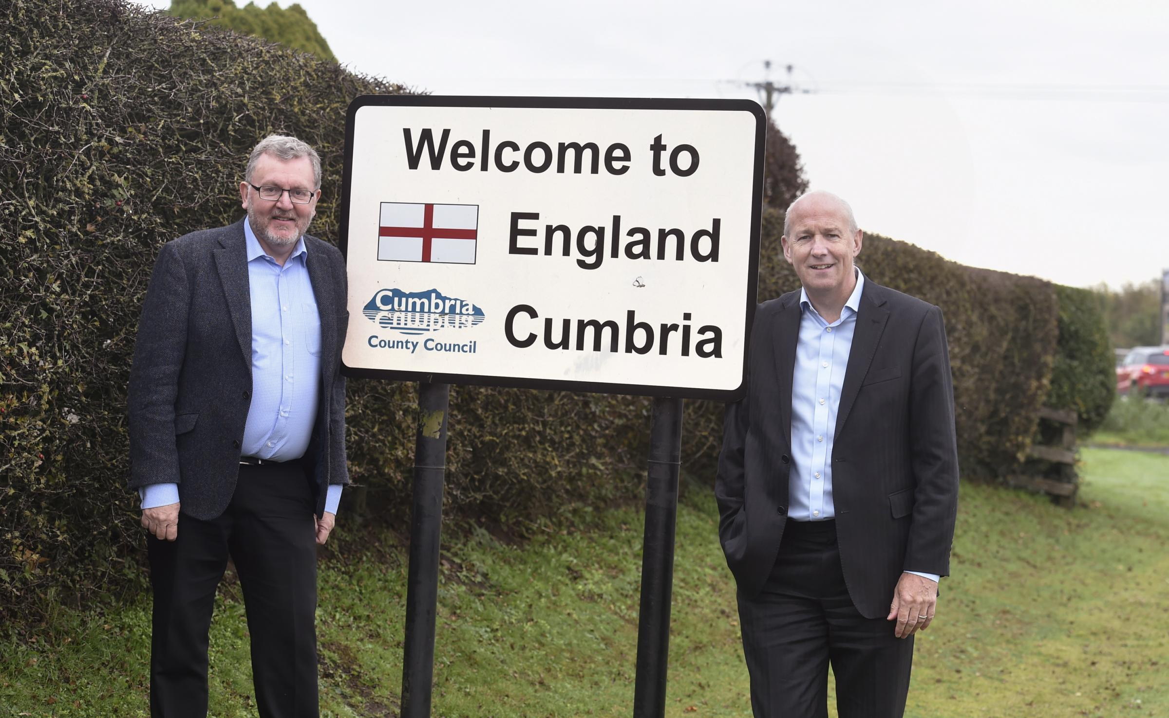 Secretary of State for Scotland and Conservative MP for Dumfriesshire, Clydesdale and Tweeddale David Mundell, left, and UK Government Borderlands Champion and Conservative MP for Carlisle John Stevenson, on the scottish/english border in Gretna, 19 Octob