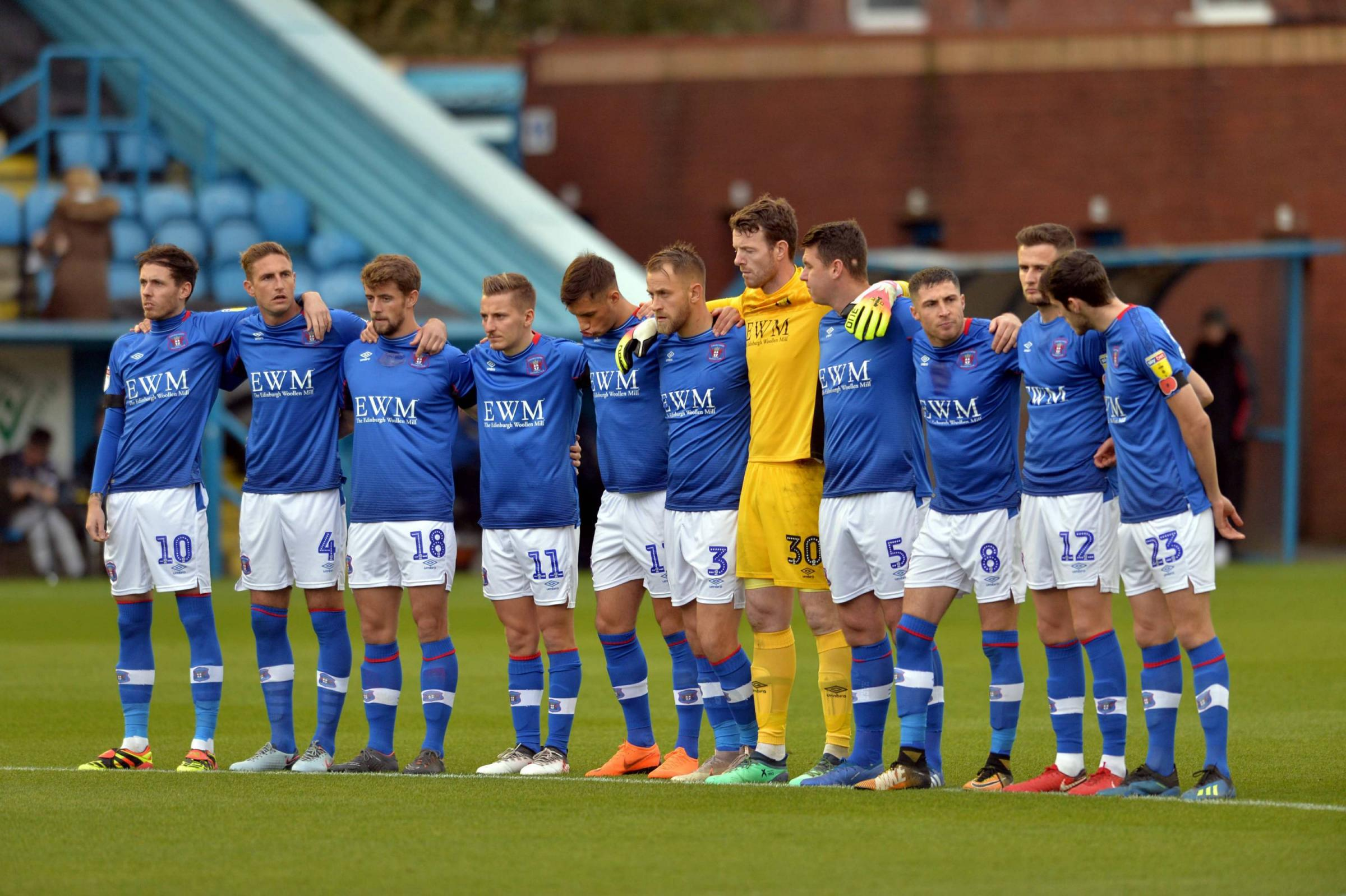 Jamie Devitt w(far left) with the armband during the minute's silence before Saturday's game