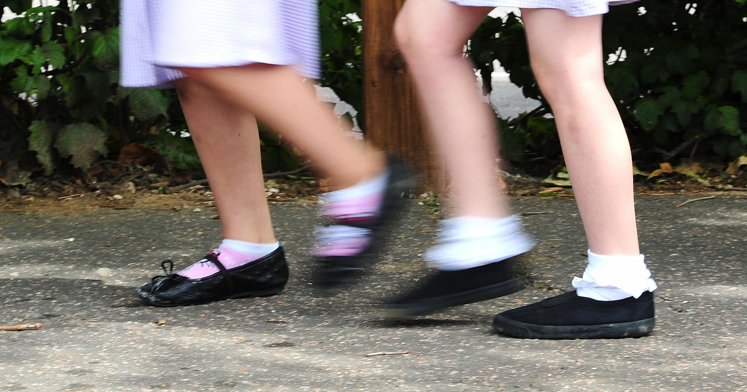 File photo date 15/07/14 of a generic stock photo of school girls walking to school. Many children are not ready to start school when they first enter a classroom, a poll of headteachers suggests. PRESS ASSOCIATION Photo. Issue date: Wednesday September 6