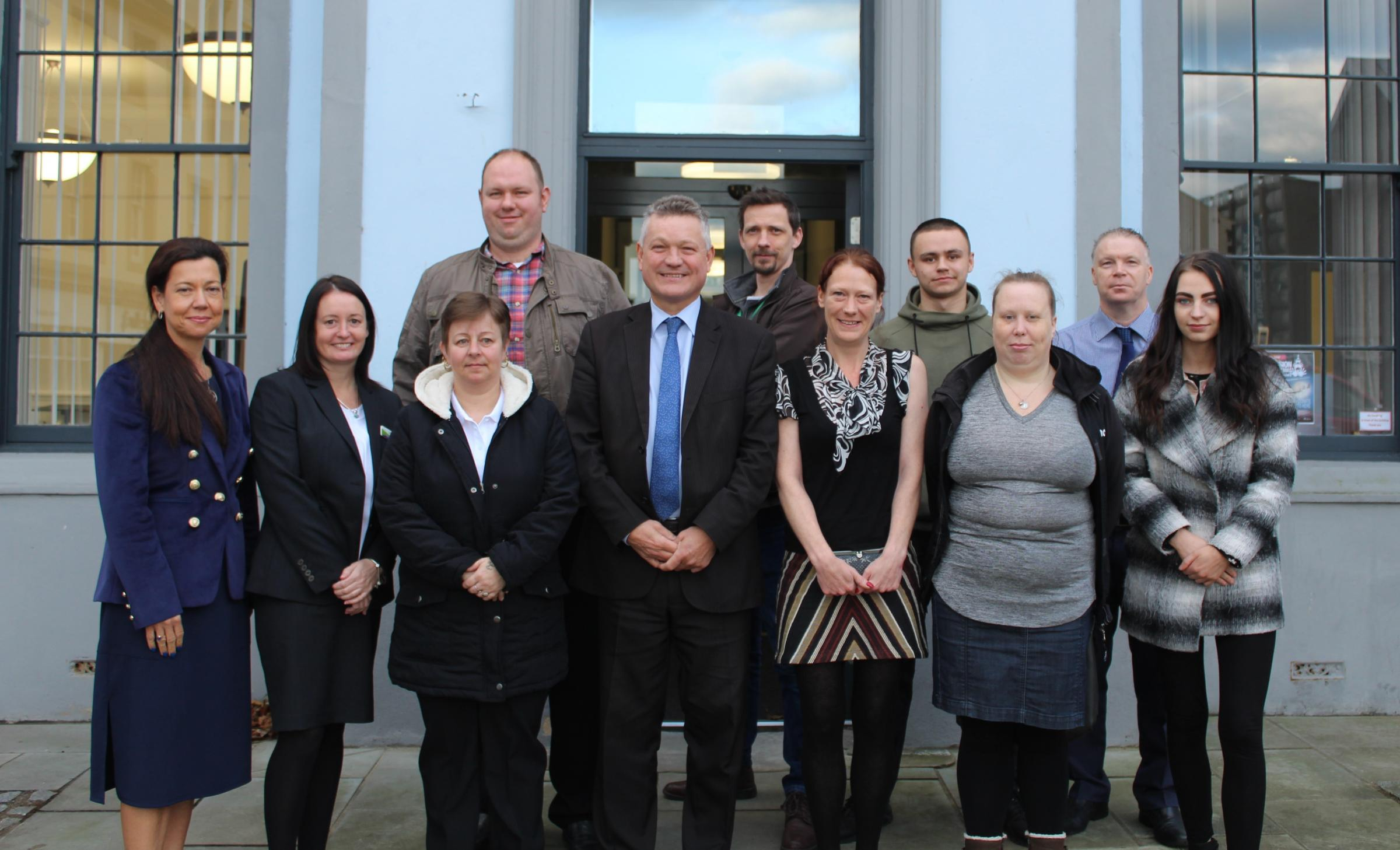 Members of Copeland Council's latest Work Academy: Firouzeh Madhoush, Reagan Skipper, Fiona Thompson, John Story, Jennifer Topliss, Jack Blackwell-Stagg, Amy Hindmarsh, and Katie Chapman, with Mayor Mike Starkie, employers Stephanie Skelly (Georgian