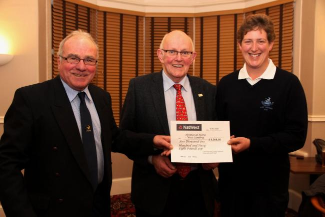 Seascale Golf Club captain Tom Oliver and lady captain Christine Fawcett hand over a cheque to Richard Stout from Hospice at Home West Cumbria