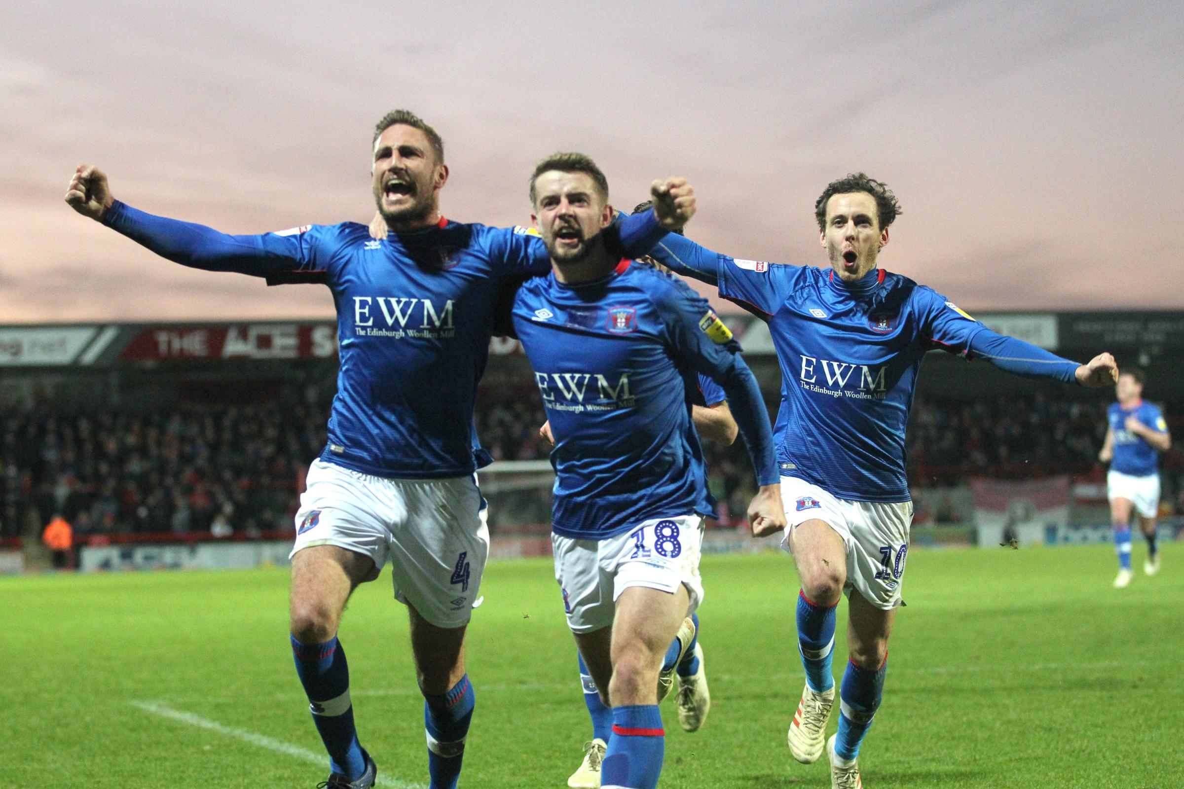 Gary Liddle, Jack Sowerby and Jamie Devitt celebrate United's second goal (photo: Barbara Abbott)