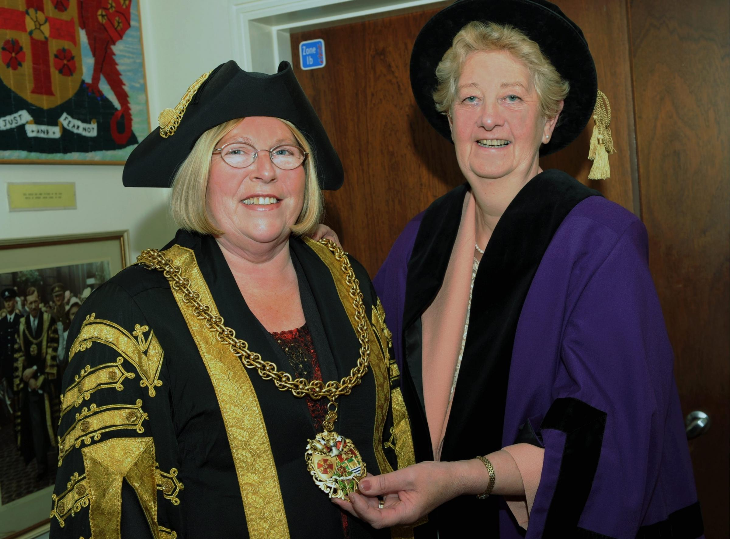FRIENDSHIP: Former Mayor Elizabeth Mallinson (right) hands over her chain to Jacquelyne Geddes in 2008