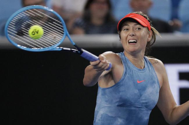Maria Sharapova brushed aside Sweden's Rebecca Peterson in their second-round match at the Australian Open (Aaron Favila/AP).