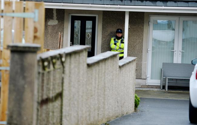 Police cordoned off Mrs Sowerby's home on Main Street, Dearham, after her son was arrested on suspicion of murder