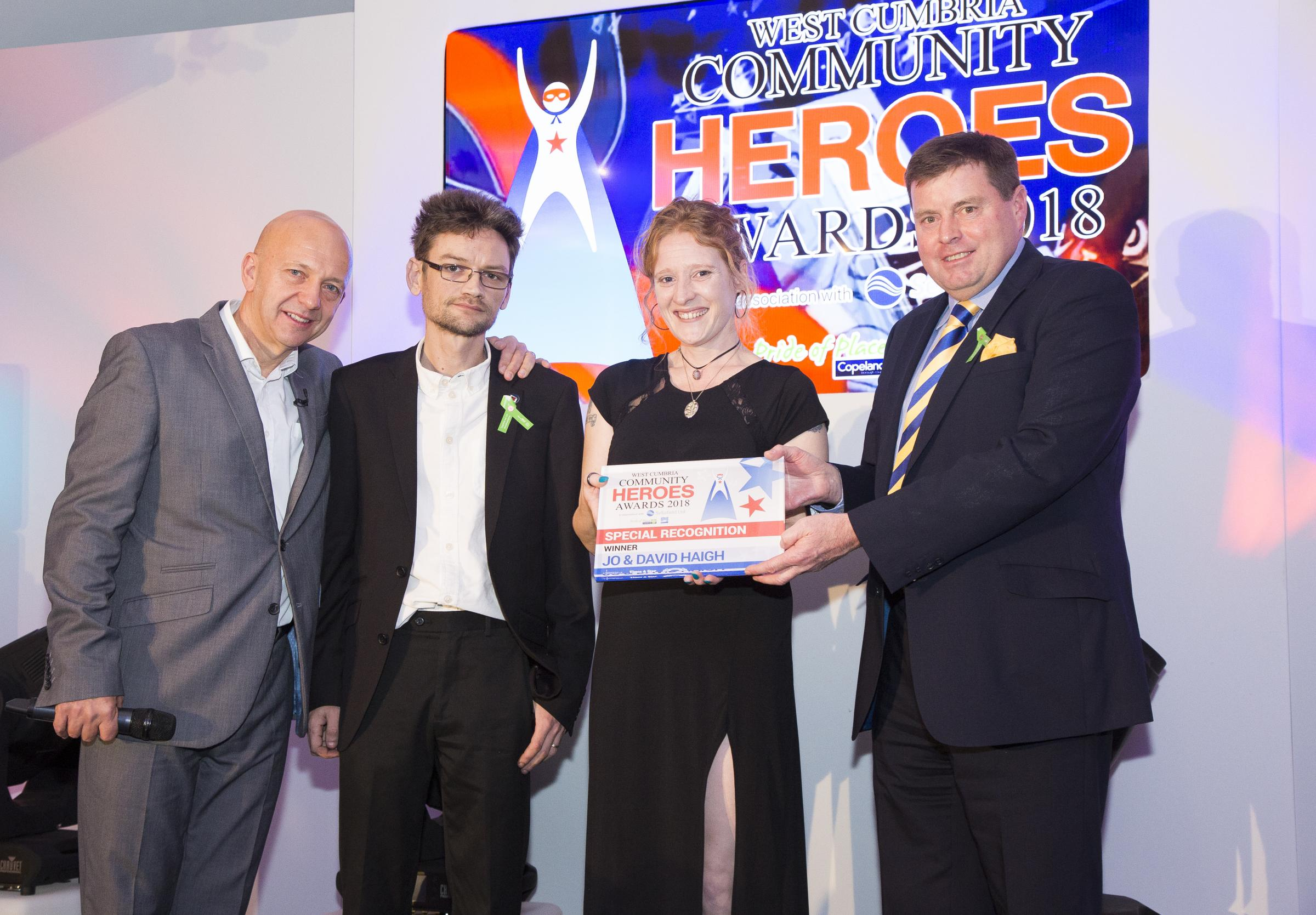 Left to right: Robbie Dee, Host, David & Jo Haigh recieving Special recognition Award, Sposnor, Peter McCall, police & Crime Commissioner,from Cumbria Police.