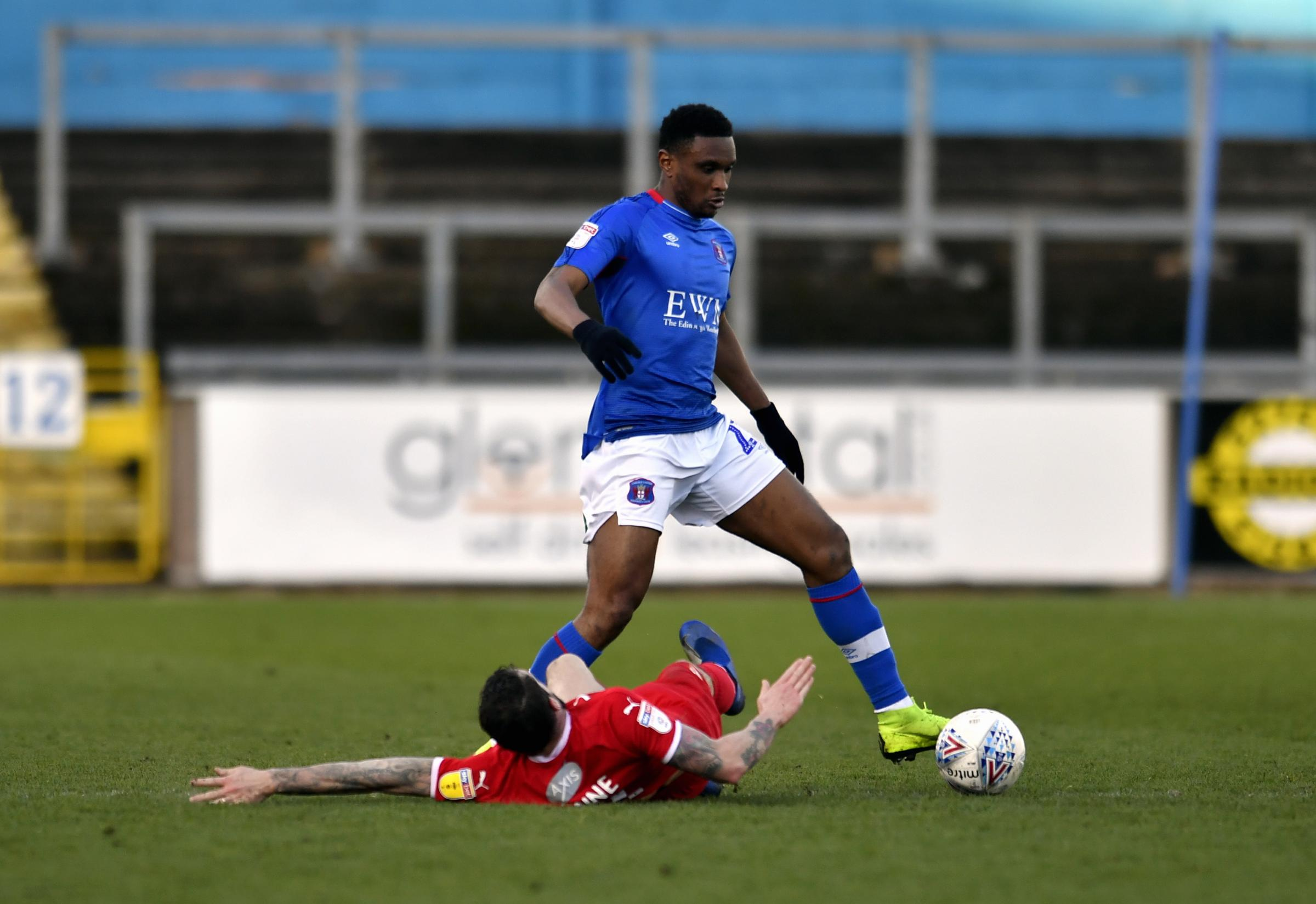 Impact: Kelvin Etuhu in action against Swindon (photo: Stuart Walker)