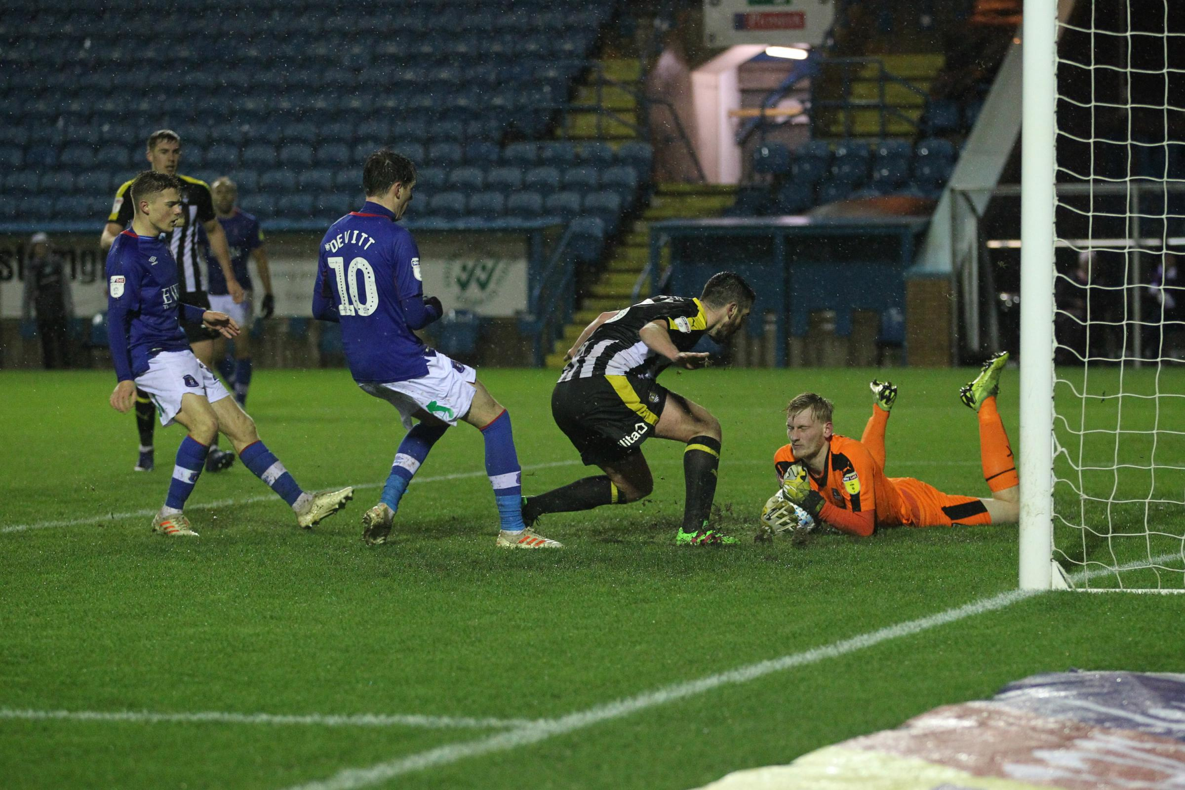 Notts' keeper Ryan Schofield pounces on the ball against Carlisle (photo: Barbara Abbott)