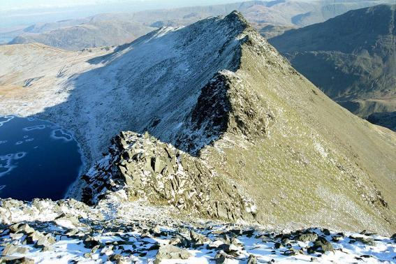 Striding Edge, Helvellyn, in winter garb, with a frozen Red Tarn bottom left PHIL RIGBY