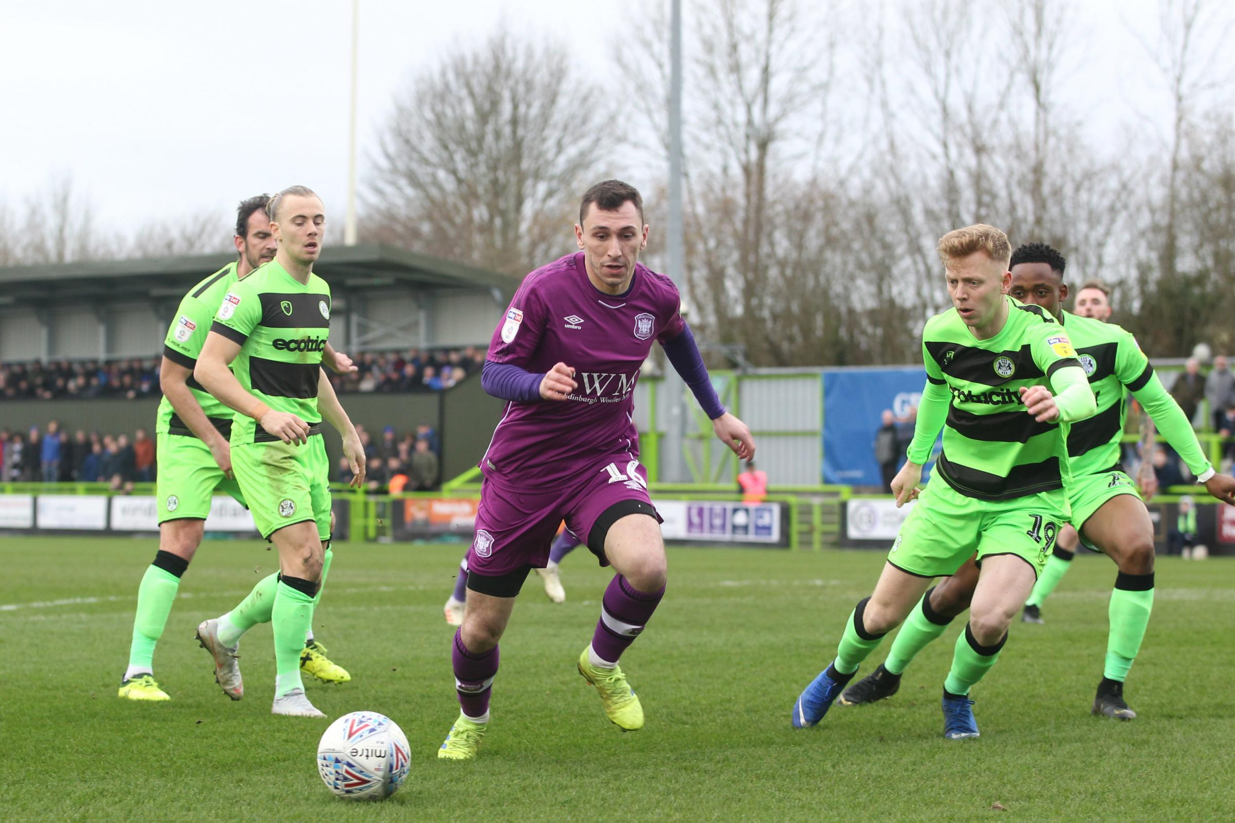 Break: Nathan Thomas cuts through the Forest Green defence