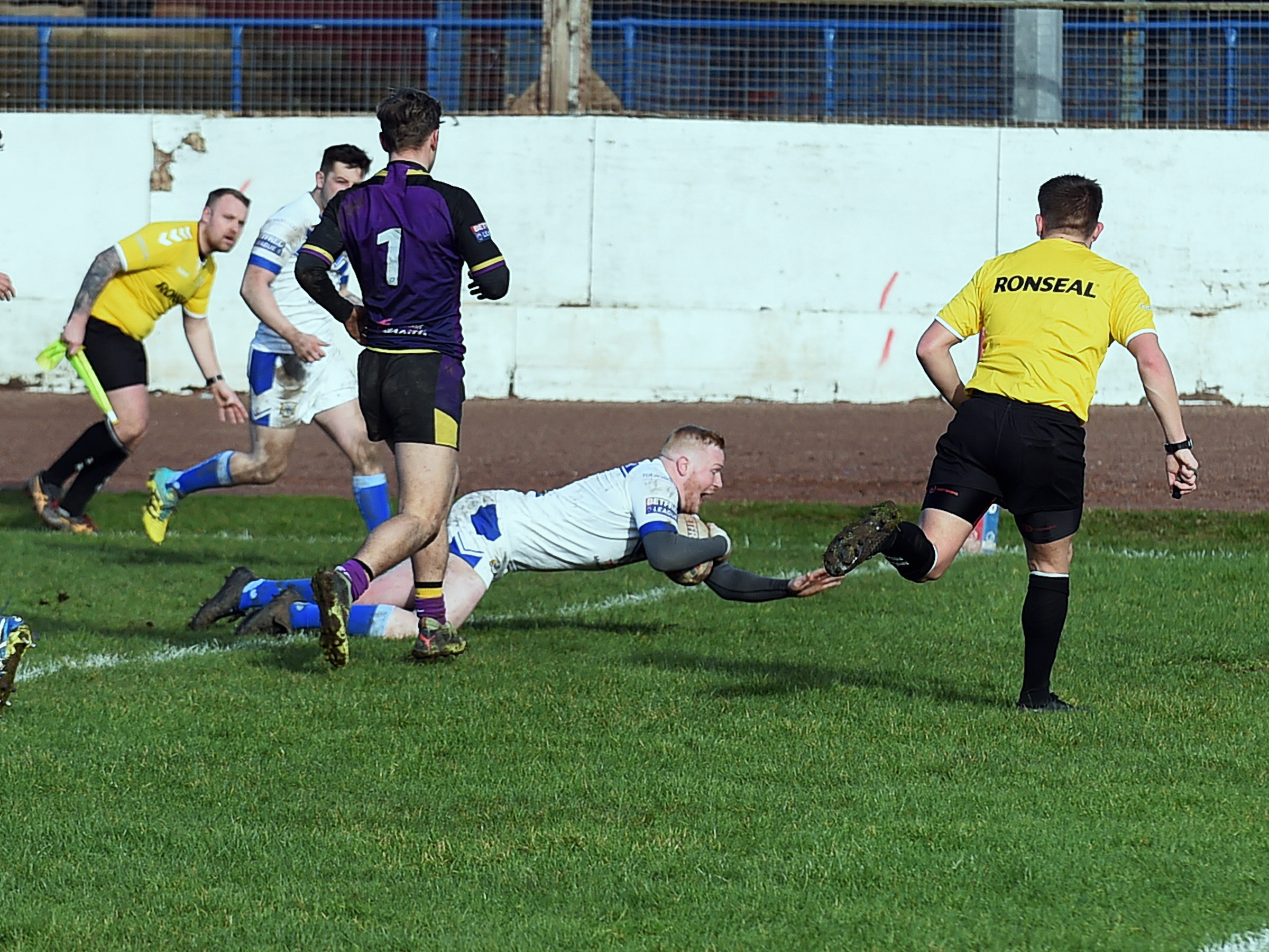 Try-time: Perry Singleton dives over to score for Workington Town (Photo: Mike McKenzie)