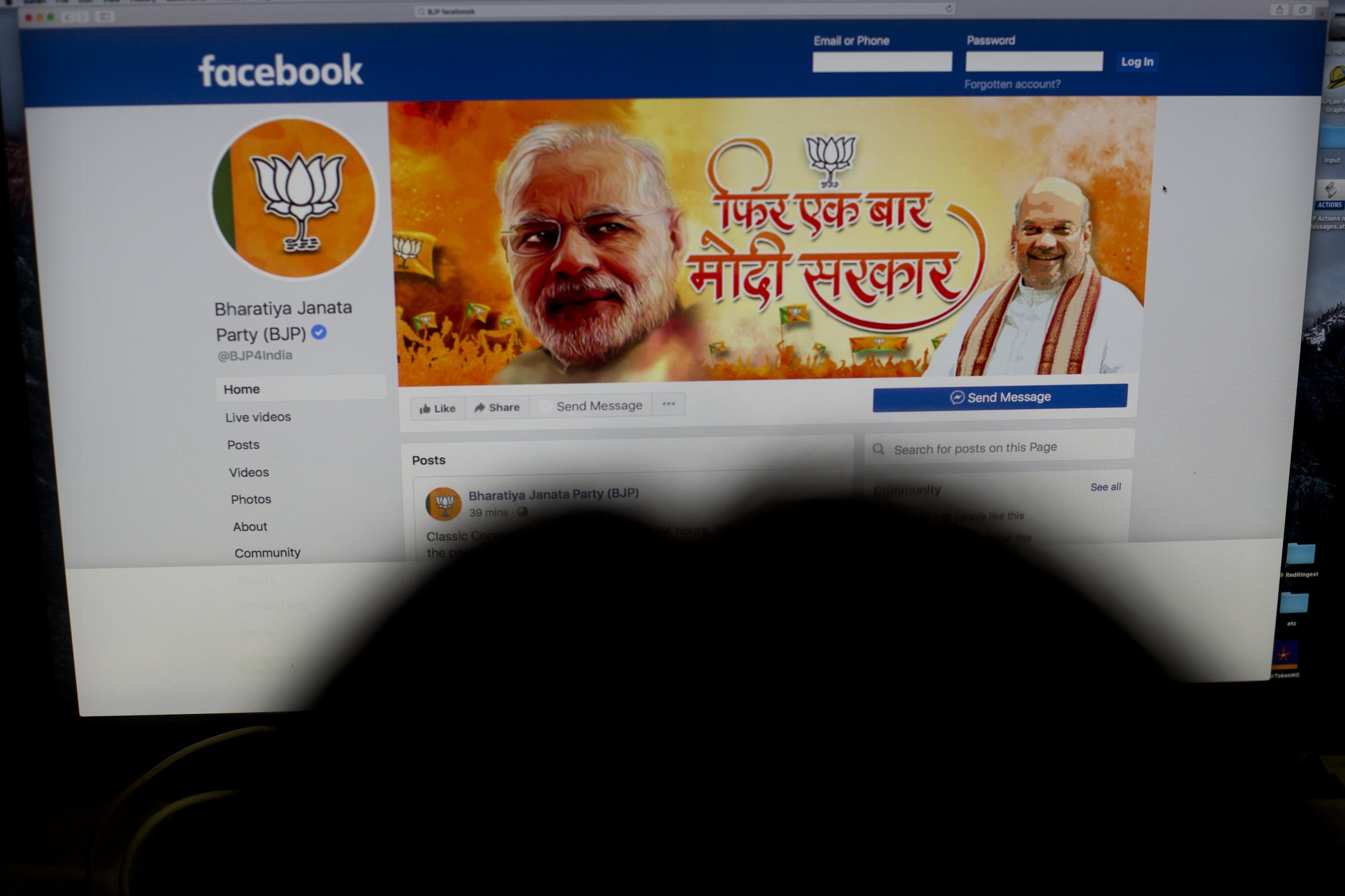 A woman checks the Facebook page of India's ruling Bharatiya Janata Party in New Delhi