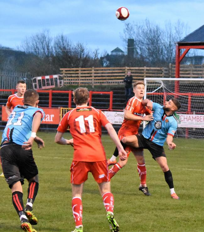 Heads up: Sam Smith battles for possession against Mickleover Sports (Photo: Ben Challis)
