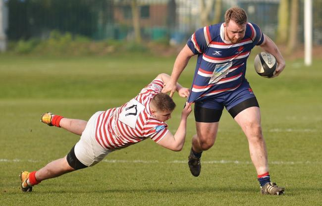 On the run: Carlisle's player-coach Matt Shields makes ground during the victory against Manchester (Photo: Bill Glendinning)