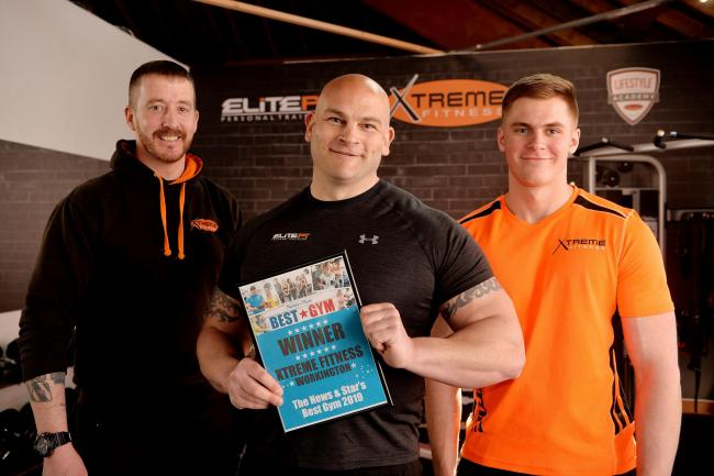 GENEROUS: Lee Butterworth (centre) from Xtreme Fitness with staff Chris McClurry and Owen Harris