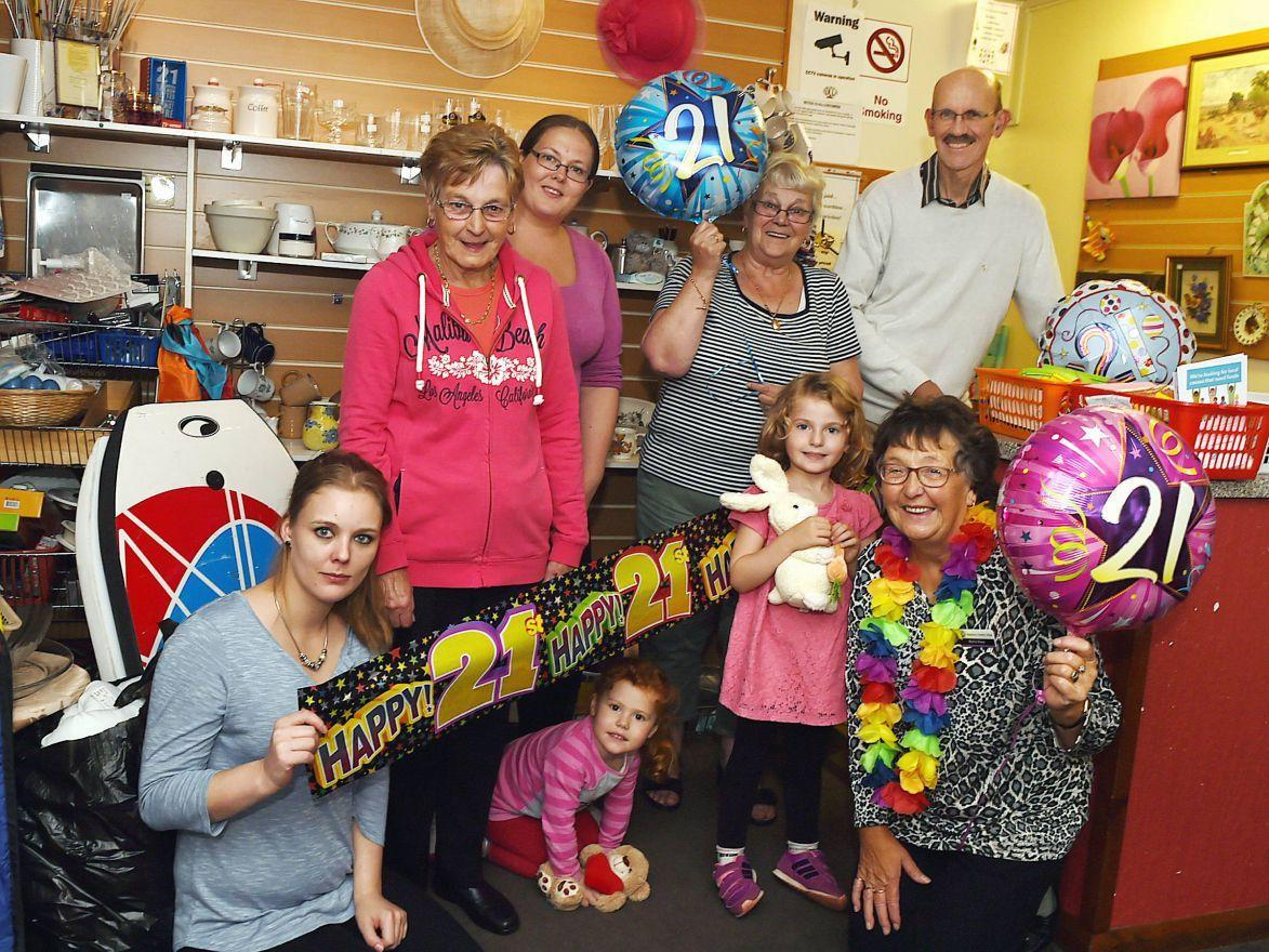CELEBRATION: Tje Aspatria charity shop celebrated its 21st birthday and has now been nominated for a Queens Award for Voluntary Service