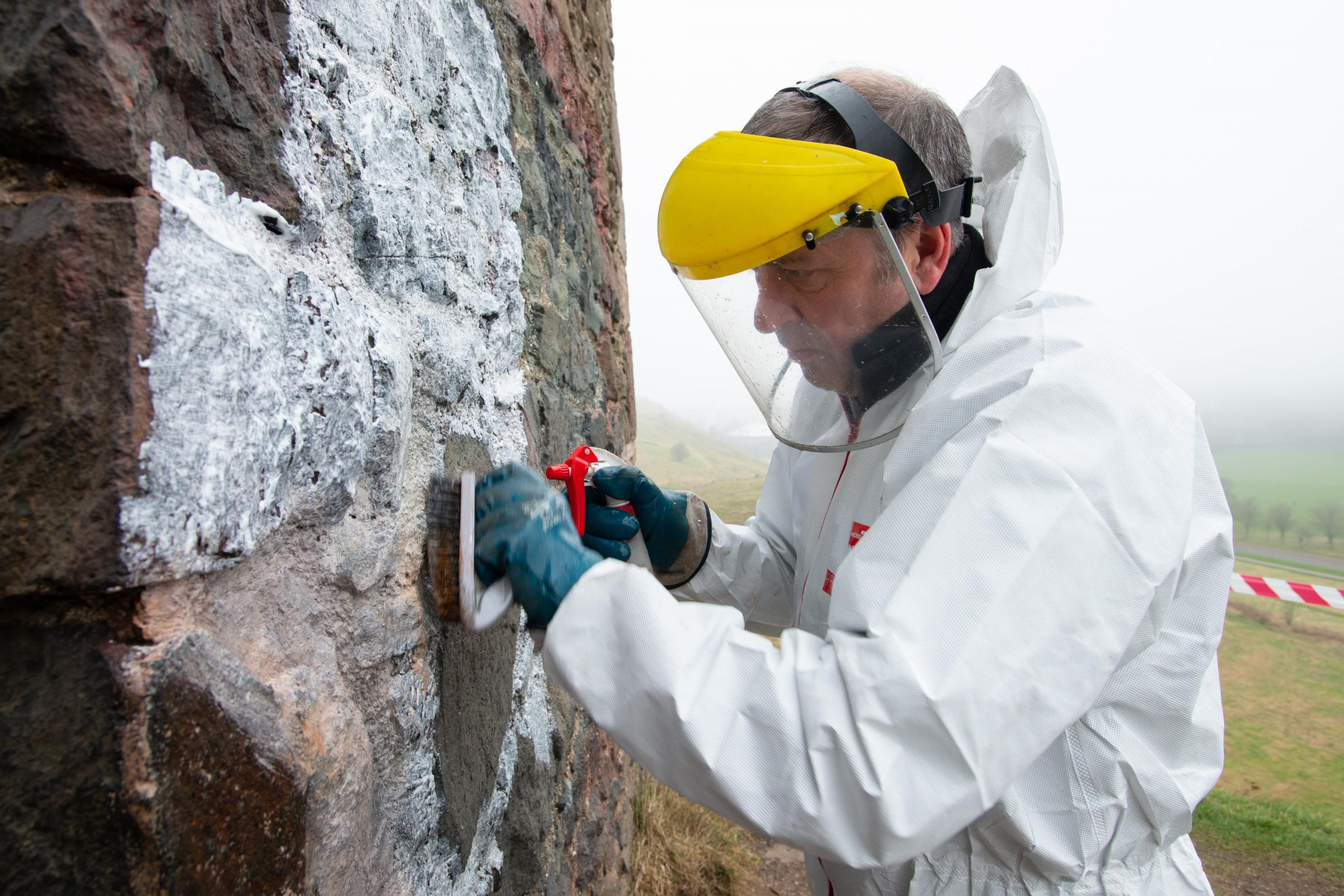 Cleaning graffiti off historic building