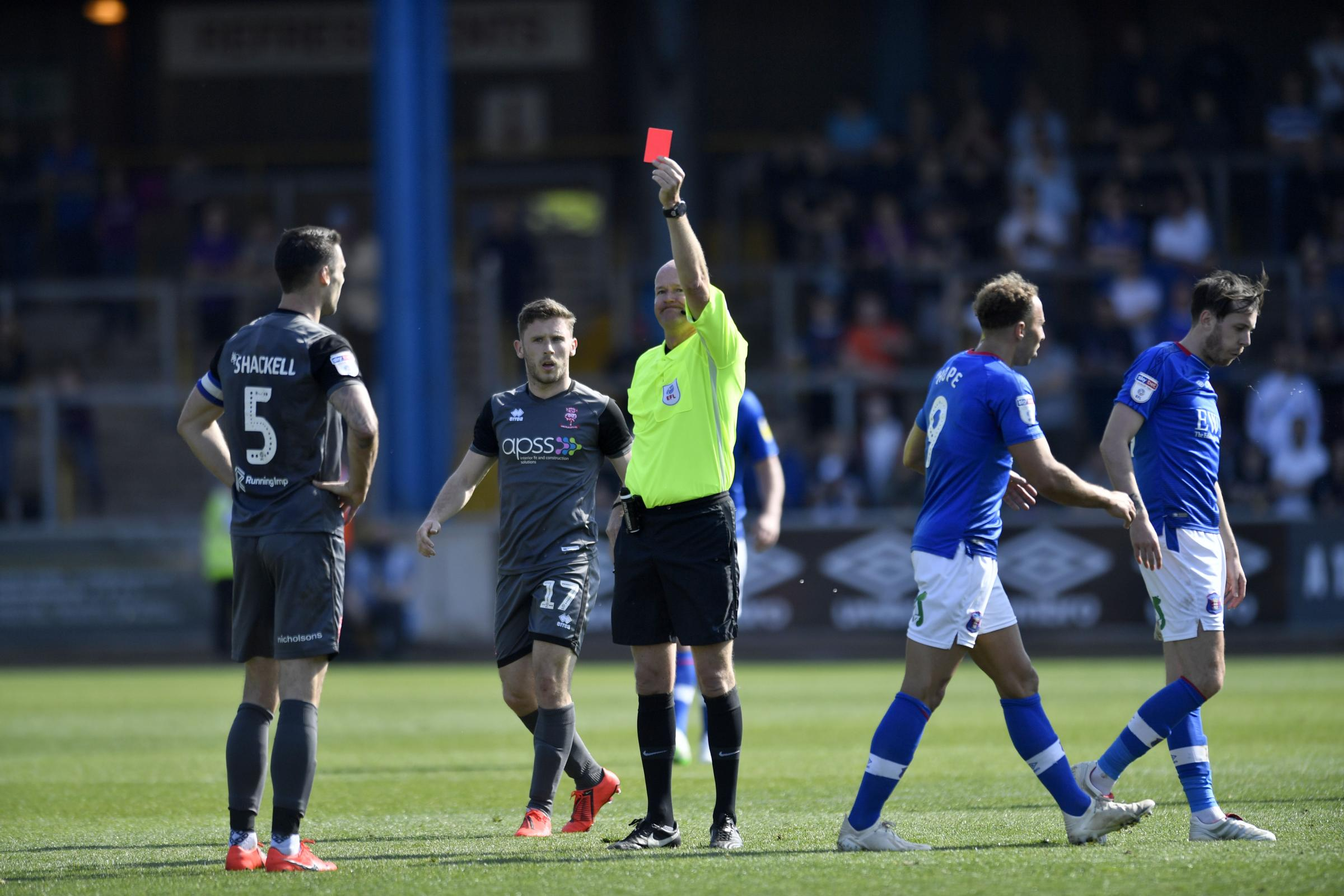Shackell is shown the red card by ref Lee Mason (photo: Stuart Walker)