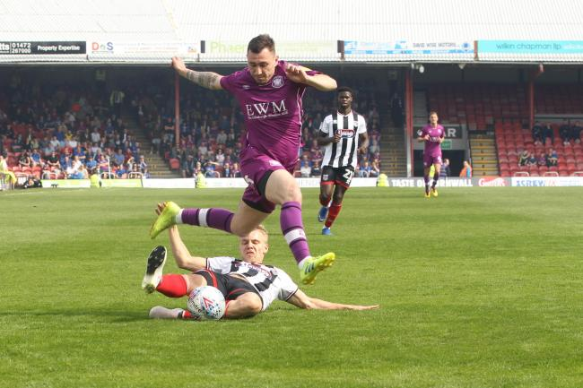 Nathan Thomas rides a challenge against Grimsby (photo: Barbara Abbott)