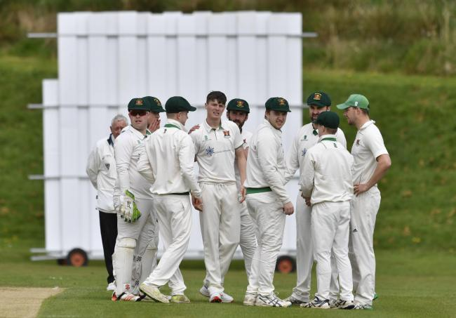 Celebrations: Carlisle Cricket Club's first-team players congratulate professional Michael Slack on taking a wicket against Keswick (Photo: Stuart Walker)