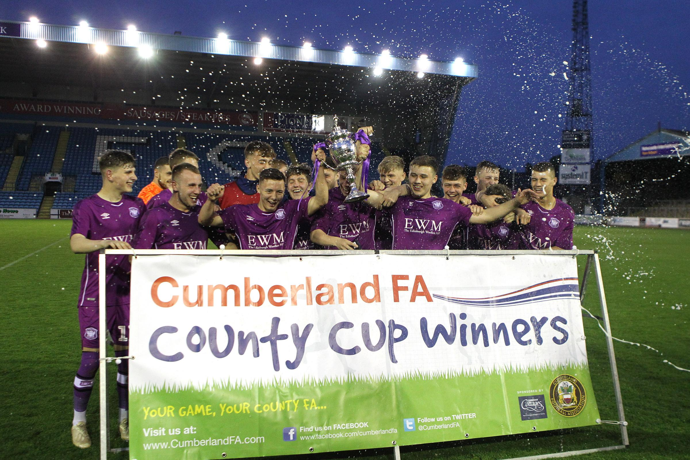 Winners: Carlisle United celebrate winning the Cumberland Cup after a 3-1 win over Penrith AFC (Photo: Barbara Abbott)