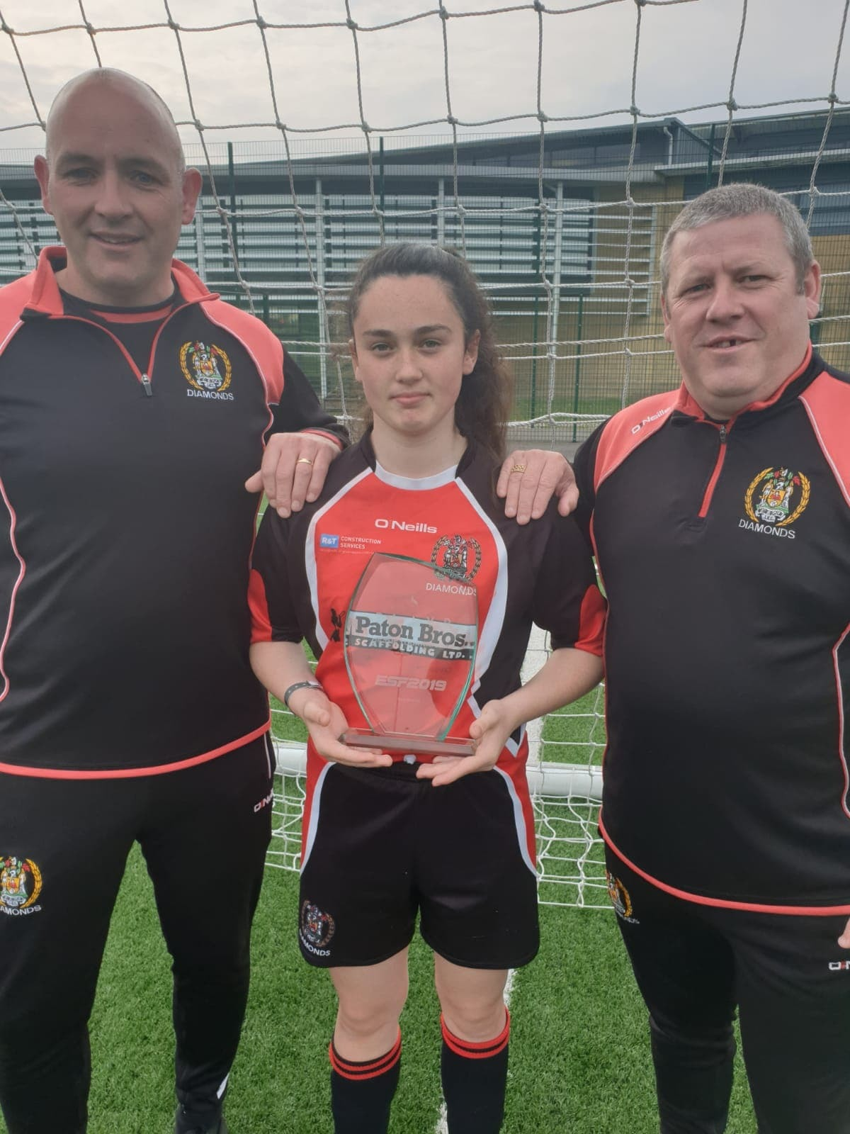 Millie Crellin with her award and Workington Diamonds coaches
