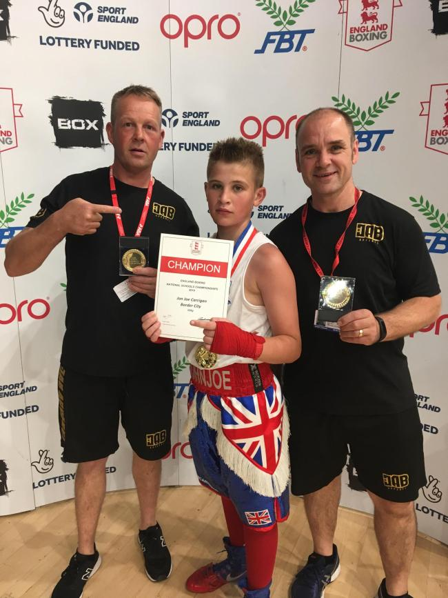 National champion: John-Joe Carrigan, centre, with coaches Ian Archibald and Dean Jopson