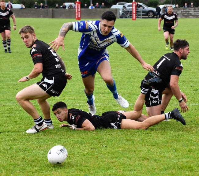 QUICK REACTIONS: Egremont's Leon Crellin dives in on the loose ball to score the winning try against Siddal                                                        Ben Challis