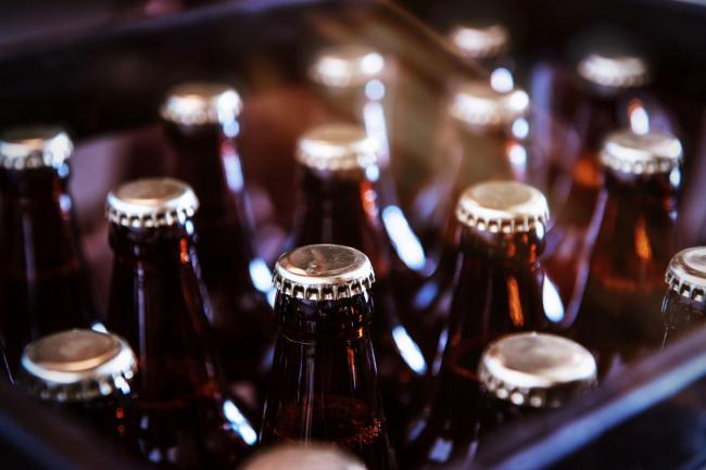 ARGUMENT: A son was put in a headlock by his dad after throwing out unopened bottles of drink