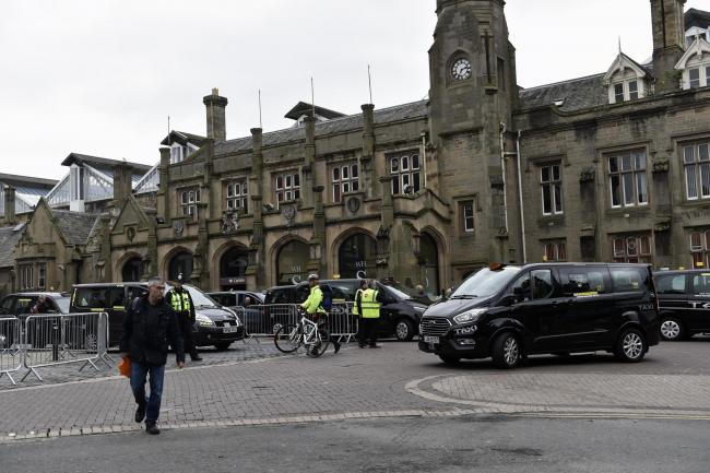 Taxi's outside Carlisle Railway Station, many with a Glasgow Taxis sticker in their windows, after trains were cancelled between Carlisle and Lockerbie today, causing congestion in Carlisle city centre, 12 June 2019  LOUISE PORTER.